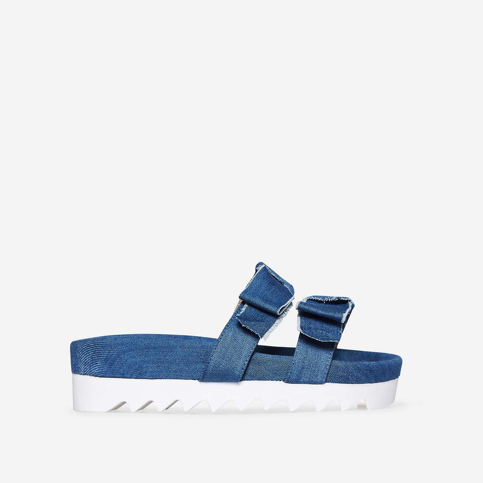 Elie Bow Slider In Light Blue Denim