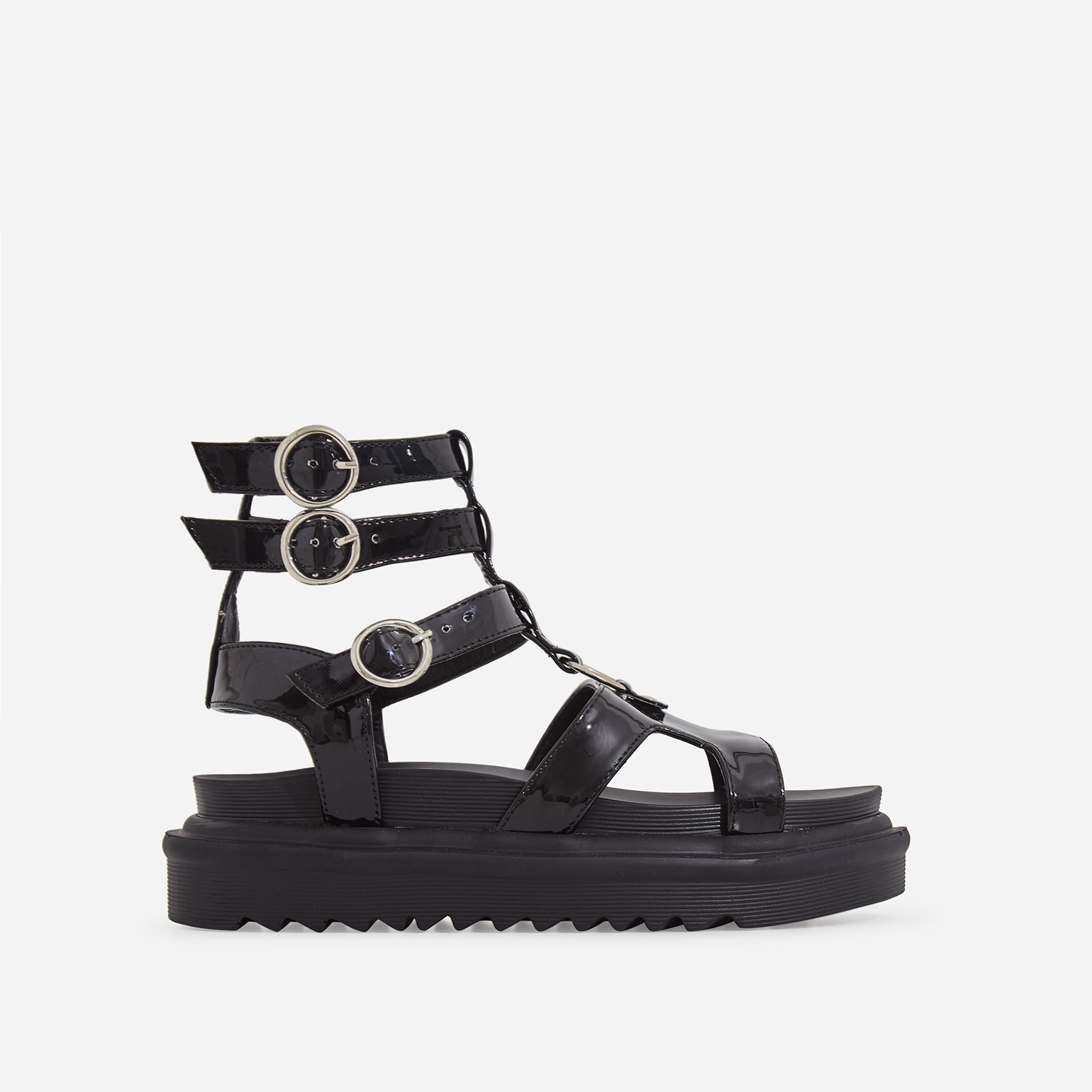 Gladys Chunky Sole Gladiator Sandal In Black Patent