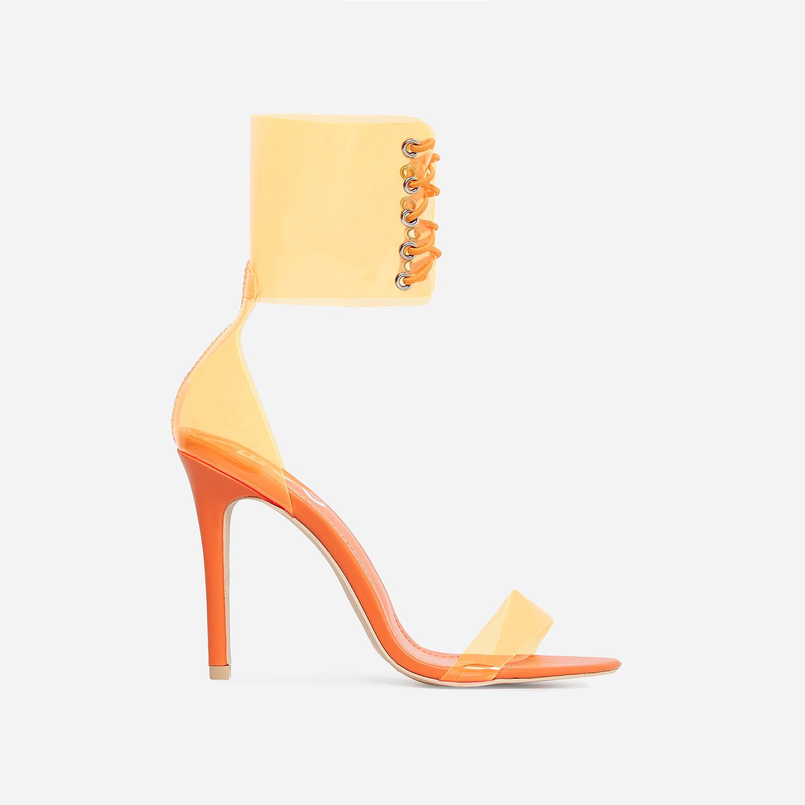 Passion Lace Up Perspex Heel In Orange Patent