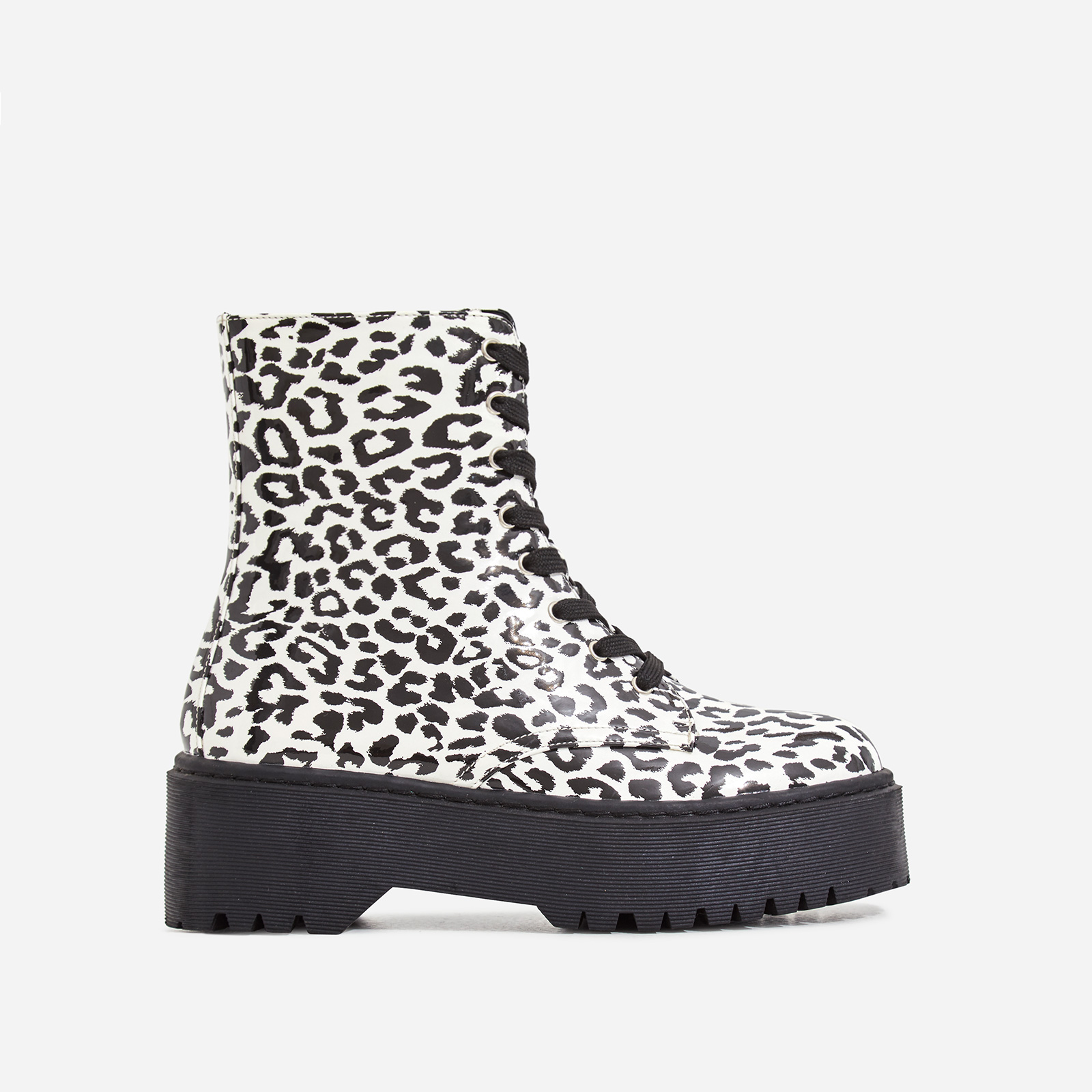 Poppin Lace Up Ankle Biker Boot In White Leopard Print Patent